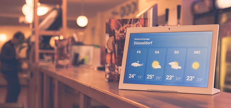 Digital Signage Tablet PC playing weather at the counter