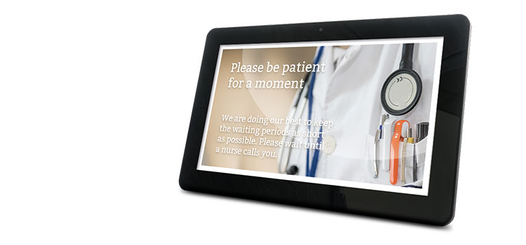 Tablet showing digital signage in healthcare